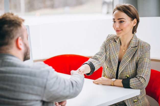 Car saleswoman talking with client Free Photo