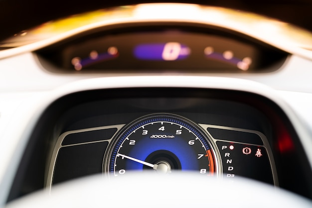 Car speed meter dashboard and cockpit, close up Photo