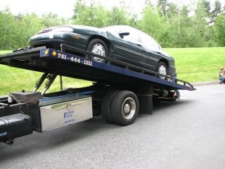Car on tow truck  car Free Photo