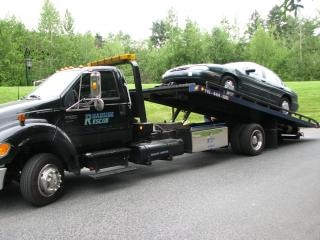 Car on tow truck Free Photo