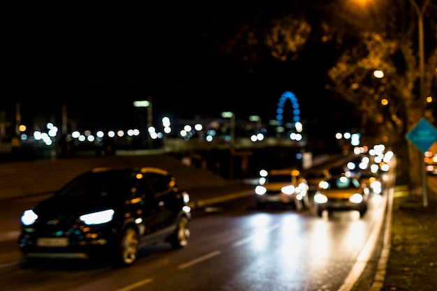 Car traffic on the night streets Free Photo