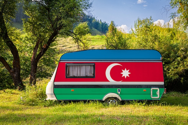 A car trailer, a motor home, painted in the national flag of azerbaijan stands parked in a mountainous. Premium Photo