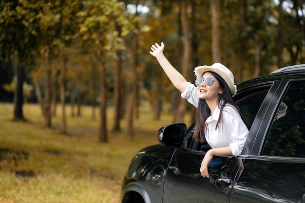 Car trip on summer,group of male and female friends enjoying traveling by car Premium Photo