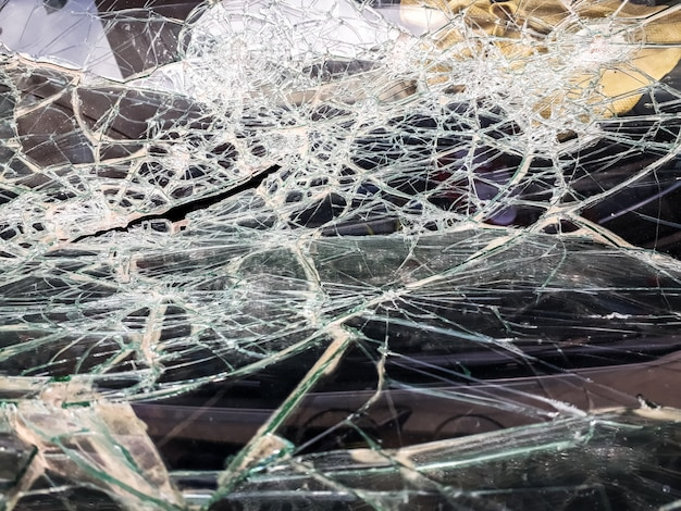 Car windshield shattered with stones by vandals. Premium Photo