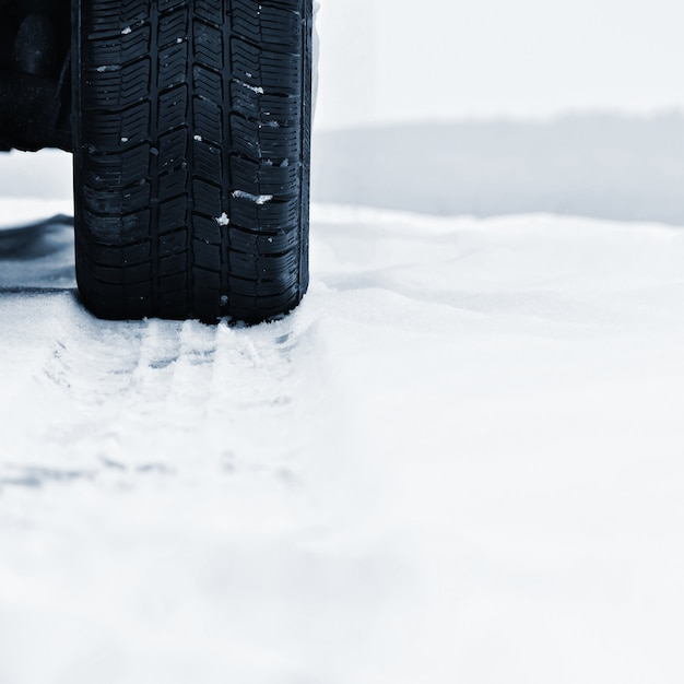 Car in winter. tire on a snowy road in bad weather. Free Photo