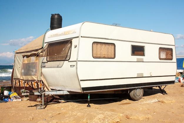 Caravan by the sea against the blue sky Premium Photo