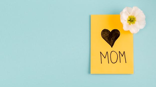 Card with heart near flower bud Free Photo