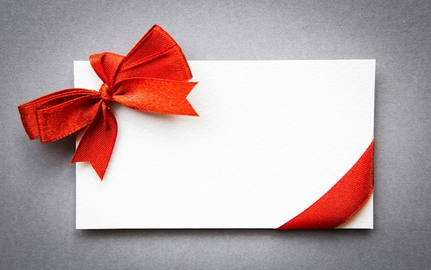 Card with red ribbons bows Free Photo
