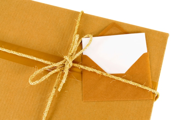 Cardboard box with blank message card Free Photo