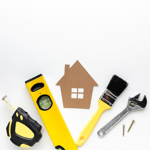 Cardboard house and repair tools with copy space Free Photo