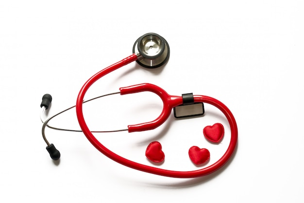 Cardiology  Medicine Close up red stethoscope and heart isolated on