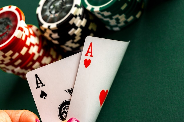 Cards and chips for poker on green table Premium Photo