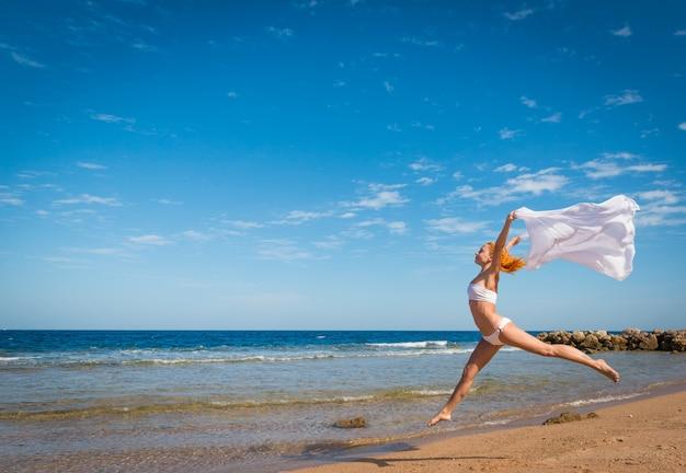 Carefree girl on the beach Free Photo