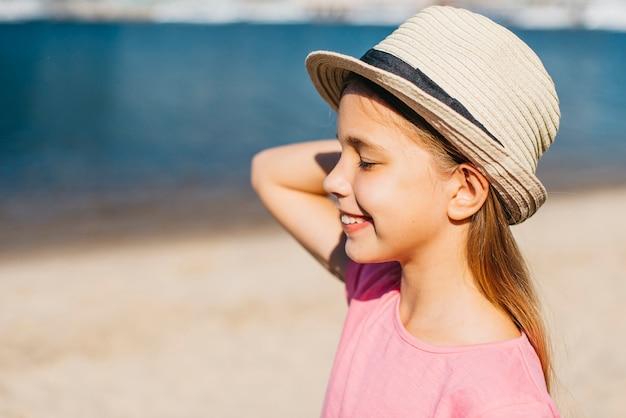 Carefree girl in hat enjoying summer Free Photo