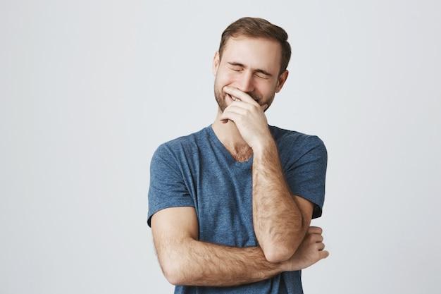 Carefree happy guy laughing over joke Free Photo