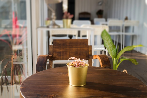 Cargo container cafe with wooden furniture set Premium Photo