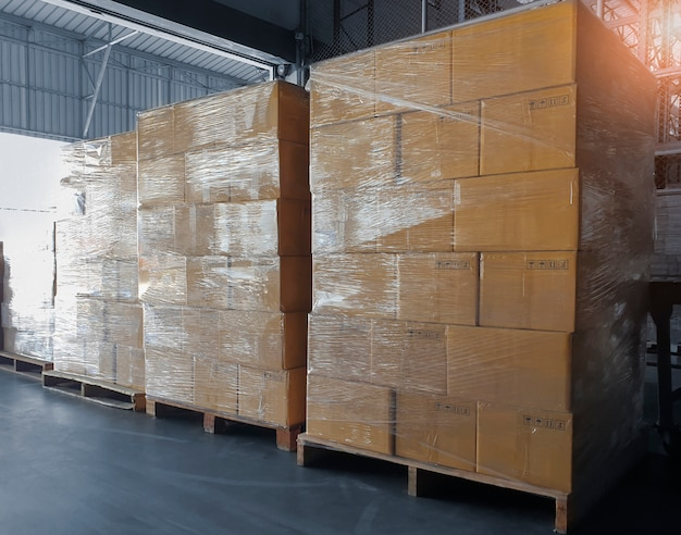 Cargo freight , shipment, delivery warehousing service. stack of cardboard boxes on wooden pallets