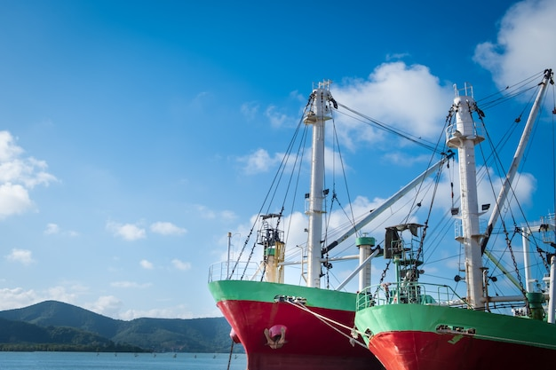 Cargo ship or fishing boat docked at jetty in songkhla Premium Photo