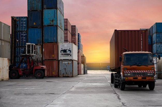 Cargo truck container transportation in a freight ship with industrial crane. Premium Photo