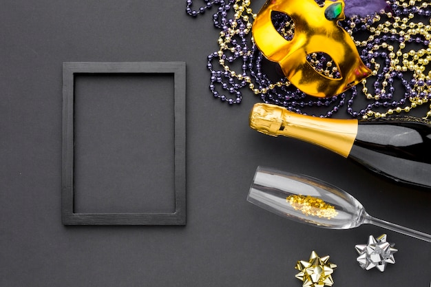 Carnival mask with champagne and jewelry Free Photo