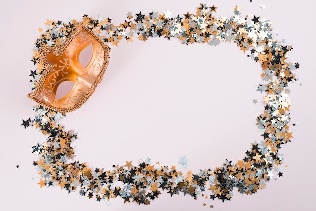 Carnival mask with small spangles on table Free Photo
