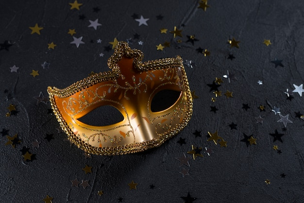 Carnival mask with spangles on dark table Free Photo