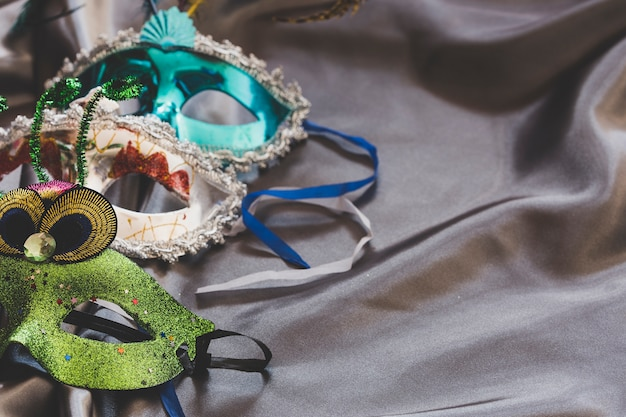 Carnival masks on silky fabric Free Photo