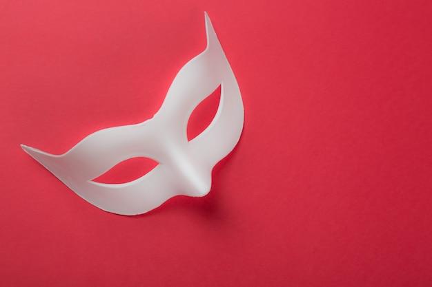Carnival venetian white mask on redd Premium Photo