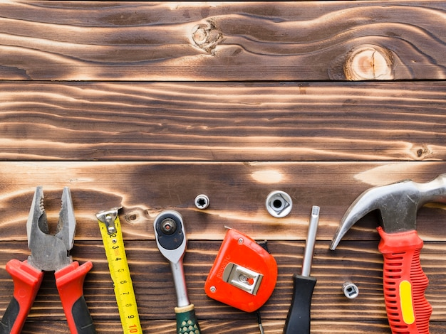 Carpenter implements on wooden desk Free Photo