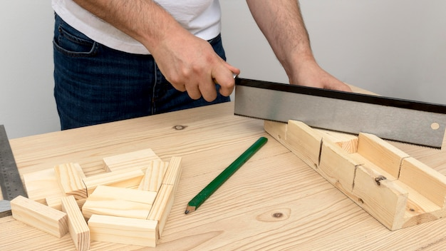 Carpenter making a design from wood Free Photo
