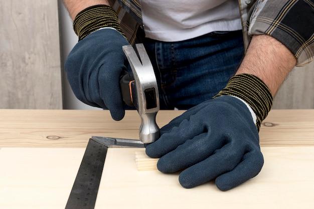 Carpenter working on wood in his workshop Premium Photo