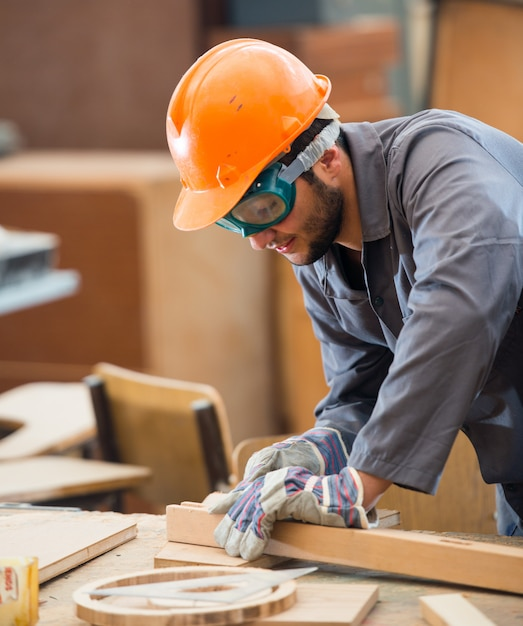 Carpenter working on wood Premium Photo