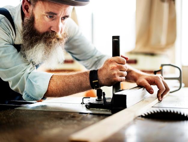 Carpenter working in workshop Free Photo