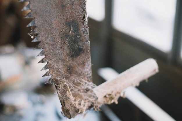 Carpentry concept with close up of saw Free Photo