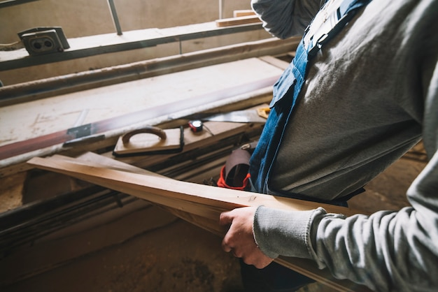 Carpentry concept with man touching wood Free Photo