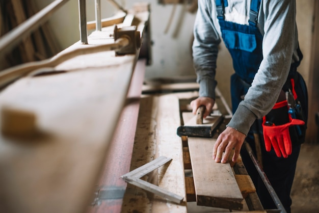 Carpentry concept with man working Free Photo