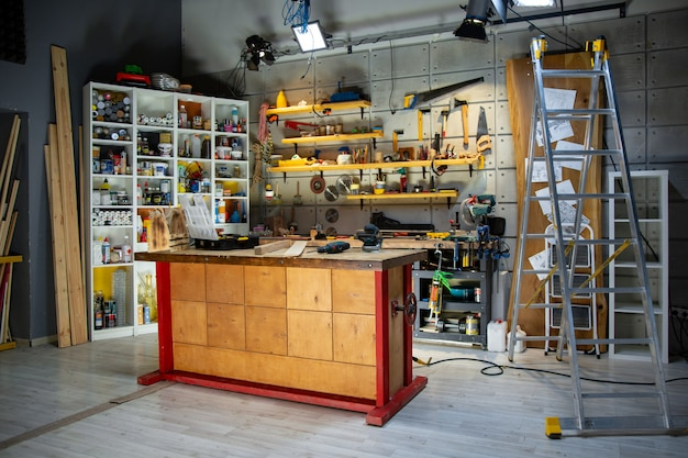 Carpentry workshop equipped with the necessary tools Premium Photo