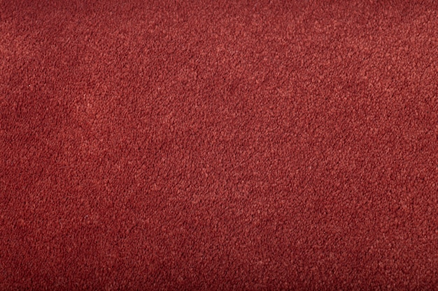 Carpet covering background. pattern and texture of burgundy colour carpet. copy space. Premium Photo