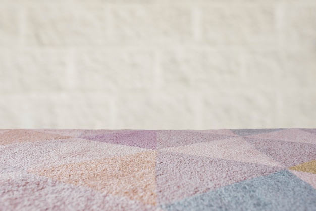 Carpet empty table with brick background Free Photo
