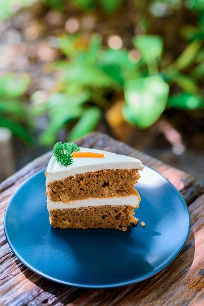 Carrot cake on a wooden table in the garden Premium Photo