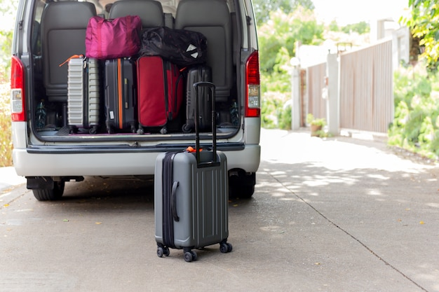 Carry-on luggage bag in mini bus travel concept. Premium Photo