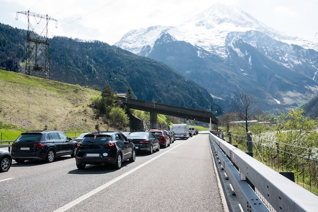 Cars stay on the road in switzerland. Premium Photo