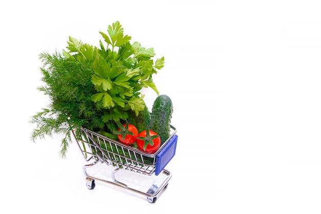 野菜とハーブの入ったカート Premium写真
