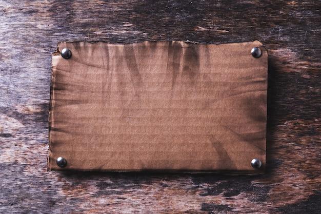 Carton frame on wooden texture Free Photo