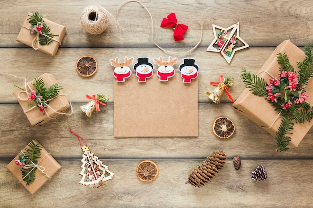 Carton tablet between present boxes Free Photo