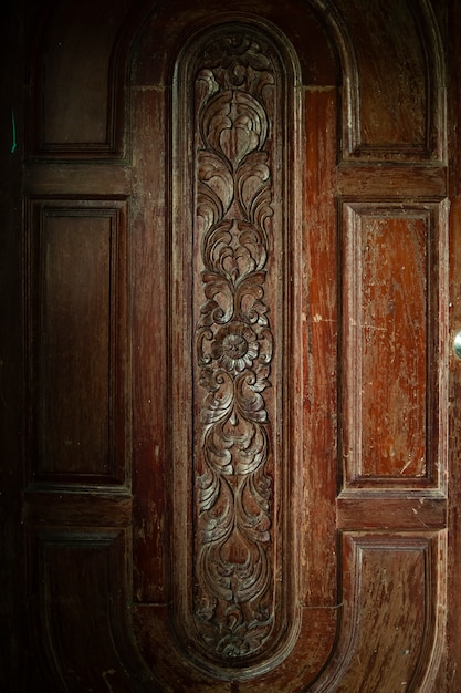 Carving on wood door surface Premium Photo