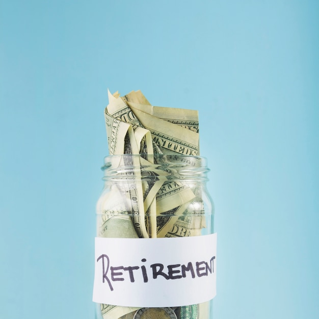 Cash in jar for retirement Free Photo