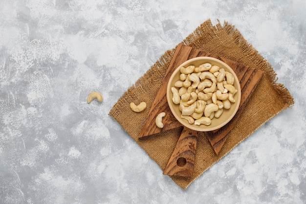 Cashew nuts in ceramic plate on concrete .top view Free Photo