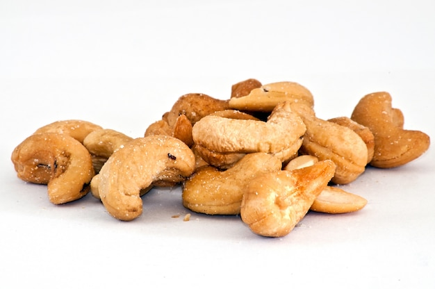 Cashew nuts isolated on the white Free Photo