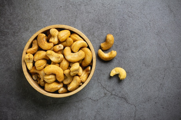 Cashew nuts with salt in bowl on table Free Photo